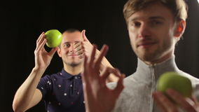 Two funny hipster friends fresh apple lifestyle portrait stock footage