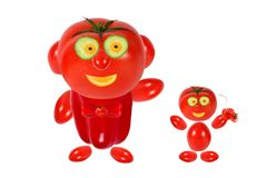 Two funny littl tomatoes standing near a bike Royalty Free Stock Image