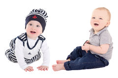 Two funny little baby boys toddlers laughing isolated on white Royalty Free Stock Photography
