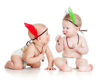 Two funny little children as Indian in diapers Royalty Free Stock Photo