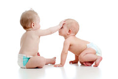 Two funny little children are playing together Royalty Free Stock Photo
