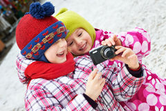 Two funny little girls with camera Stock Images
