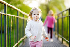 Two funny little girls running with joy and happines stock images