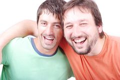 Two funny men are laughing. Wideli and huging each other Stock Images