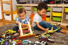 Two funny and messy baby brothers playing together Stock Photography