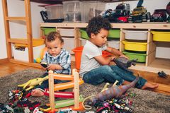 Two funny and messy baby brothers playing together Stock Image