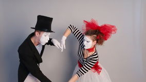 Two funny mimes holding invisible heart stock video