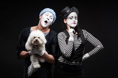Two funny mimes holding red heart