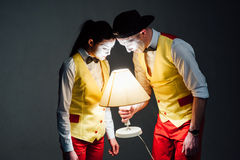 Two funny mimes isolated on gray background Stock Photos