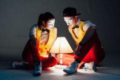 Two funny mimes isolated on gray background Stock Photo