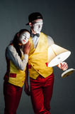Two funny mimes isolated on gray background Royalty Free Stock Photography