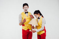 Two funny mimes isolated on white background. lamp royalty free stock photos
