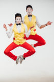 Two funny mimes jumping on white background Stock Photography