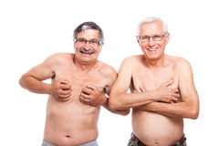Two funny naked seniors Royalty Free Stock Images
