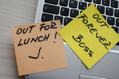 Two funny notes on a laptop. Of an employee going out for lunch and of the boss who fires him Stock Photos