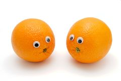 Two funny oranges with eyes on white Royalty Free Stock Image