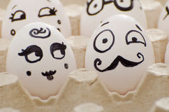 Two funny painted eggs, a lady and a gentleman Royalty Free Stock Photos