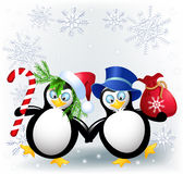 Two funny penguin. With Christmas candy and gift bag Royalty Free Stock Photography