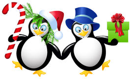 Two funny penguin. With Christmas gifts Stock Photo