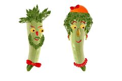 Two funny portrait of men and women, made from zucchini Stock Images
