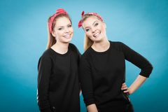 Two funny positive retro styled female portrait stock photography