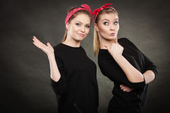 Two funny positive retro styled female portrait. Stock Photo