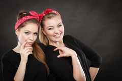 Two funny positive retro styled female portrait. Good humor concept. Retro style and old fashion. Two smiling happy girls in red handkerchief. Women styled on Stock Image