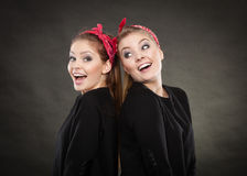 Two funny positive retro styled female portrait. Good humor concept. Retro style and old fashion. Two smiling happy girls in red handkerchief. Women styled on Royalty Free Stock Image
