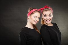 Two funny positive retro styled female portrait. Good humor concept. Retro style and old fashion. Two smiling happy girls in red handkerchief. Women styled on Stock Photography