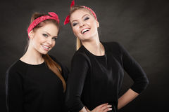 Two funny positive retro styled female portrait. Good humor concept. Retro style and old fashion. Two smiling happy girls in red handkerchief. Women styled on Royalty Free Stock Images