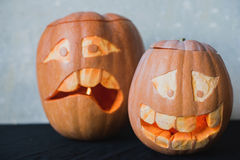 Two funny pumpkin for Halloween on a black background Stock Photos