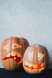 Two funny pumpkin for Halloween on a grey background Royalty Free Stock Photography