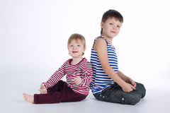 Two funny siblings portraits on white background Stock Photography
