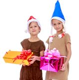 Two funny sisters with gifts in their hands Royalty Free Stock Images