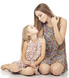 Two funny sisters laughing and kissing isolated on the white bac Stock Images