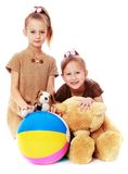 Two funny sisters with toys Royalty Free Stock Photography
