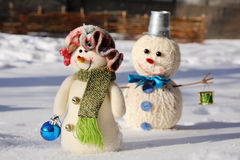 Two funny snowman in snow Royalty Free Stock Photography