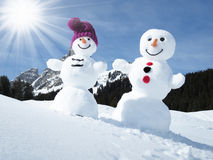 Two funny snowmen. In the Alps Royalty Free Stock Photo