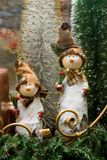 Two funny snowmen on the sill. Two funny snowmen in the shop window Royalty Free Stock Images
