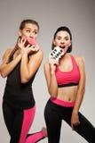 Two funny sporty ladies. Studio shot Royalty Free Stock Photos