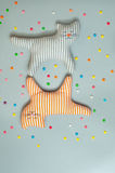 Two funny textile cat toys over grey background Royalty Free Stock Image