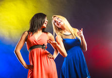 Two funny women in dresses. Stock Photography