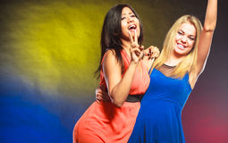 Two funny women in dresses. Royalty Free Stock Image