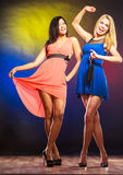 Two funny women in dresses. Stock Image