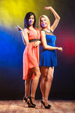Two funny women in dresses. Stock Images