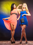 Two funny women in dresses. Stock Photos