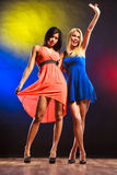 Two funny women in dresses. Stock Photo
