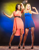 Two funny women in dresses. Royalty Free Stock Images