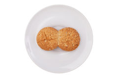 Two fused-glass cookies on a white saucer  Royalty Free Stock Photo