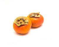 Two Fuyu persimmon isolated Stock Photos